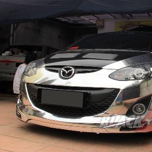Tampak muka Mazda2 setelah proses wrapping cutting sticker