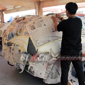 Bodi yang tidak di airbrush, dilapis dengan koran